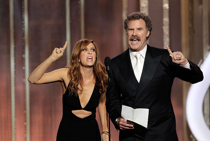 Presenters Kristen Wiig (L) and Will Ferrell on stage at the 70th annual Golden Globe Awards. — Reuters Photo