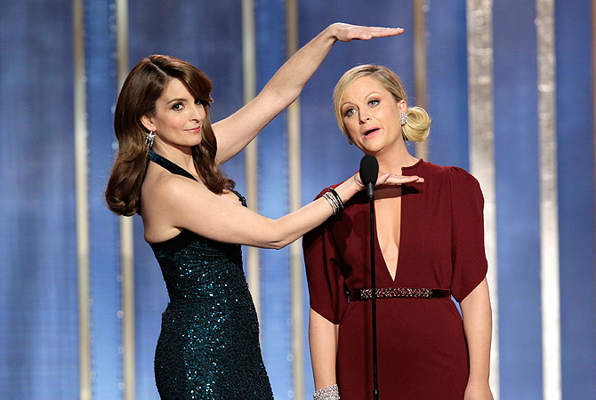 Hosts Tina Fey (L) and Amy Poehler perform on stage at the 70th annual Golden Globe Awards in Beverly Hills, California January 13, 2013, in this picture provided by NBC. — Reuters Photo
