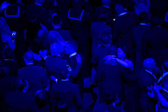 A heartwarming view of service members and their loved ones dancing during the ball. ?Photo by AFP