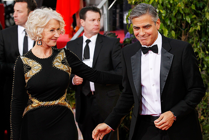 Actress Helen Mirren greets actor George Clooney as they arrive at the 70th annual Golden Globe Awards in Beverly Hills. — Reuters Photo
