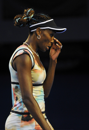 Venus Williams of the US touches her nose during her women's singles match against Maria Sharapova of Russia at the Australian Open tennis tournament in Melbourne. ? Photo by Reuters