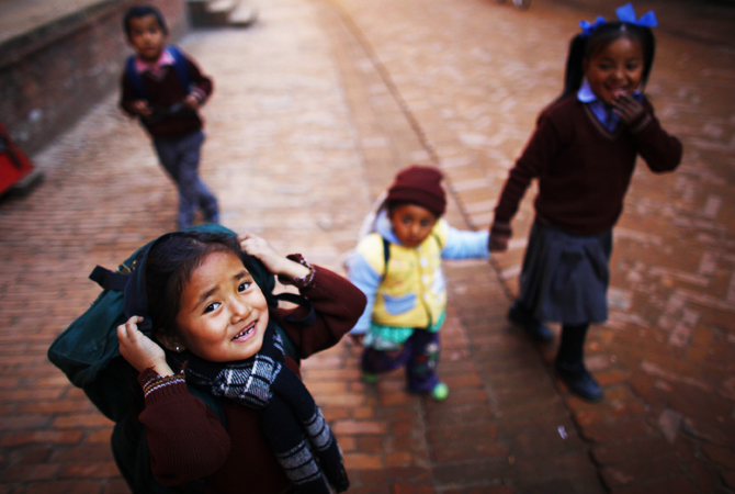 Nepalese children walk home from school at Bhaktapur.