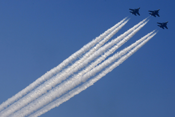 The Indian Air Force's Russian-made Sukhoi-30 aircrafts fly past during the Republic Day parade in New Delhi.