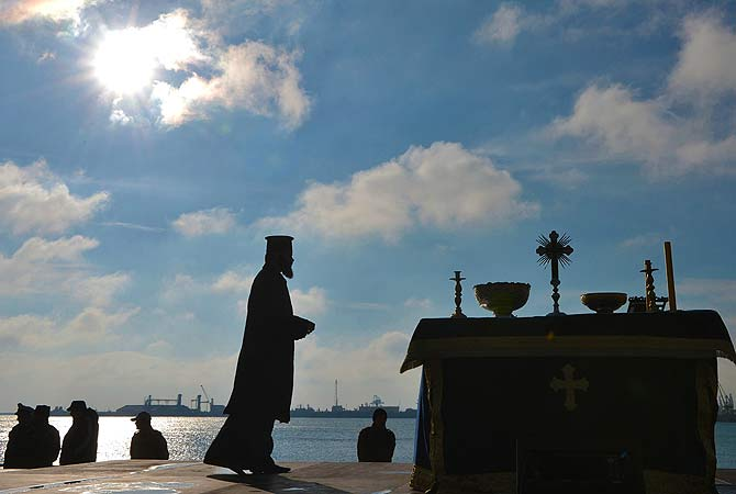 A Romanian priest prepares the epiphany religious service in Constanta city (230km east from Bucharest) on January 6, 2013. Thousands of Romanian Orthodox believers attended the celebration of Epiphany in the Black Sea coastal city. ? AFP Photo