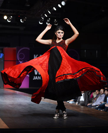 A Pakistani model presents a piece from Vasim Asghar's Moulin Rouge-inspired collection. ?Photo by AFP