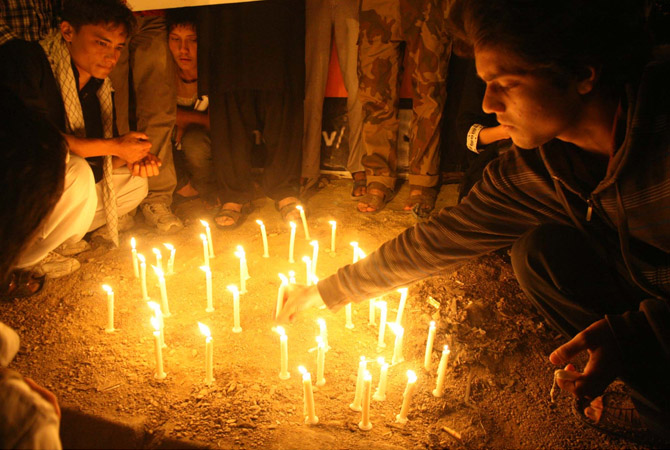 People light candles as they are protesting against genocide of Shiite Muslims and dual bomb blasts at Qandhari Imambargah Alamdar  Road in Quetta that caused 86 people killed belonged to Shiite Hazara community, during a 