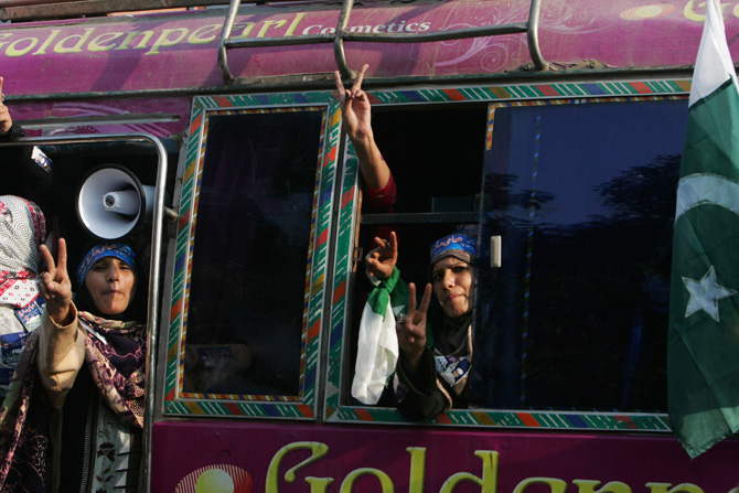 Supporters react in a bus during a protest march from Lahore to Islamabad January 13, 2013. ? Photo by Reuters