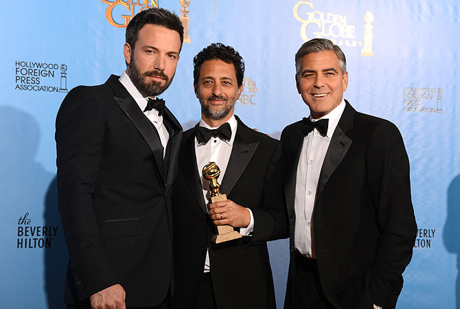 "Actor/director Ben Affleck (L) poses in the press room with producers Grant Heslov (C) and George Clooney with the award for best motion picture drama for ""Argo"" at the Golden Globes awards ceremony in Beverly Hills. — AFP Photo"