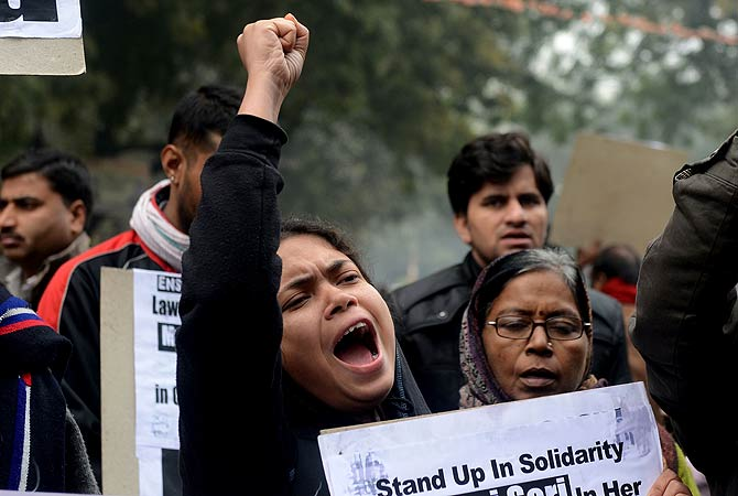 "Indian protestors shout anti-government slogans during a protest against rape in New Delhi on January 2, 2013.  The family of an Indian gang-rape victim said that they would not rest until her killers are hanged as police finalised their investigation before charges are laid against suspects this week. As the ruling Congress party reportedly pushed for tougher punishments for sex crimes, including chemical castration, authorities in New Delhi launched a hotline to improve safety for women in a city dubbed ""India's"