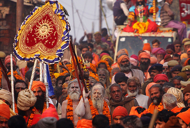 Indian Hindu Saddhus (holy men) participate in a religion procession in preparation for the Kumbh Mela at Sangam in Allahabad on January 4, 2013. The Kumbh Mela, which is scheduled to take place in the northern Indian city in January and February 2013, is the world's largest gathering of people for a religious purpose and millions of people gather for this auspicious occasion. ? AFP Photo