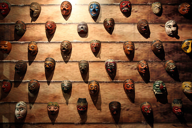 Various wooden masks from Javanese and Balinese culture in Indonesia are displayed during the Masks of the World exhibition at the National Museum in Kuala Lumpur. ? AFP Photo