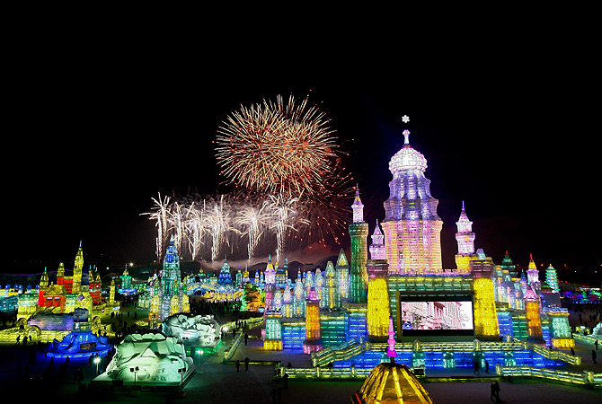 Fireworks explode over ice sculptures during the official opening of the 29th Harbin International Ice and Snow Festival in Harbin. ? AP Photo