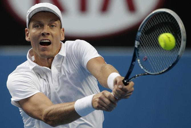 Tomas Berdych of the Czech Republic makes a backhand return to Austria's Jurgen Meltzer during their third round match at the Australian Open tennis championship in Melbourne. ? Photo by AP