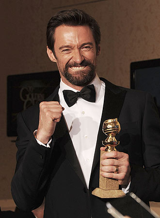 "Actor Hugh Jackman poses in the press room with his Best Performance by an actor in a motion picture comedy or musical award for ""Les Miserables""at the Golden Globes awards. — AFP Photo"