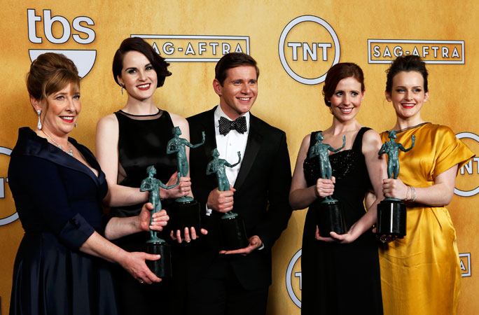 Cast members of the TV drama ?Downton Abbey? hold their award for ?Outstanding Performance by an Ensemble in a Drama Series? backstage. ?Photo by Reuters