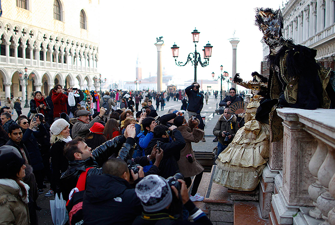 Marco Dilauro and his wife Nadia, wearing costumes, pose at San Marco square during the Venice Carnival. ? Reuters Photo