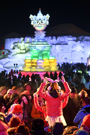 This picture taken on January 5, 2013 shows people visiting Ice and Snow World at the opening ceremony of the 2013 Harbin Internatoinal Ice and Snow Festival. ? AFP Photo