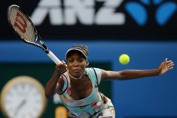 Venus Williams of the US makes a forehand return to Russia's Maria Sharapova during their third round match at the Australian Open tennis championship in Melbourne, Australia, Friday. ? Photo by AP