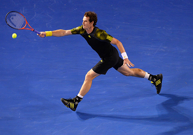 Britain's Andy Murray hits a return against Serbia's Novak Djokovic during the men's singles final on day 14 of the Australian Open tennis tournament in Melbourne on January 27, 2013.  – Photo by AFP