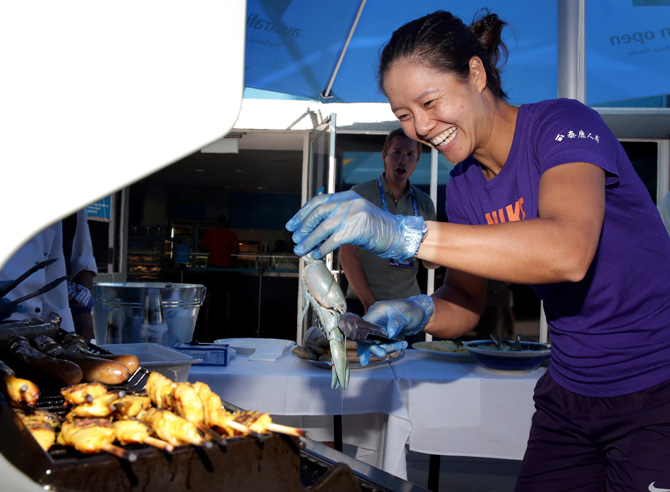 "Li Na of China barbeques a small freshwater crayfish, known locally as a ""Yabby"", in the Player's Cafe at the Australian Open tennis tournament in Melbourne, in this handout photograph provided by Tennis Australia January 22, 2013. – Photo by Reuters"