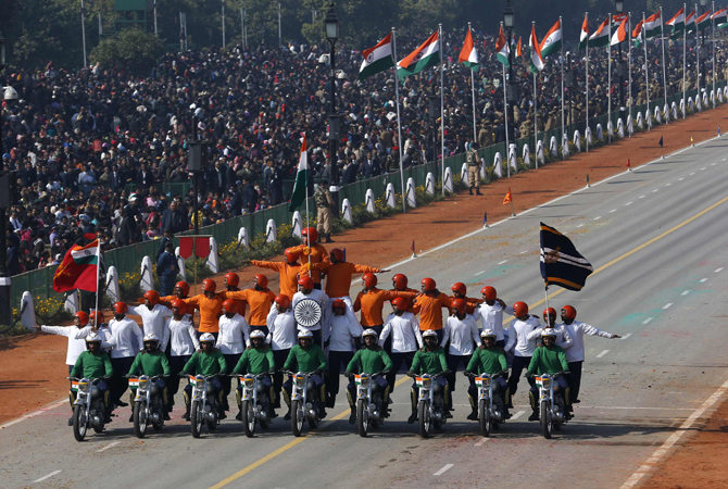 Indian Army soldiers perform a daredevil stunt during the Republic Day parade in New Delhi January 26, 2013. India celebrated its 64th Republic Day.