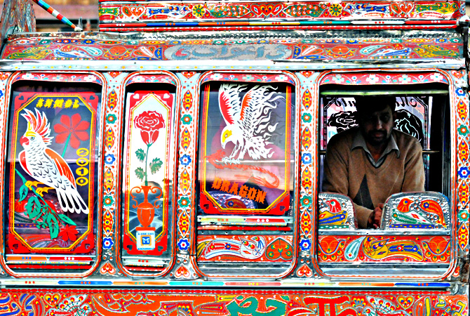 A commuter travels in a decorated minivan in Rawalpindi. — AFP Photo