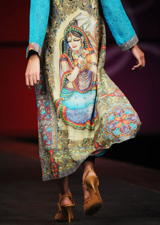 A Pakistani model wears a colourful presentation with Indian motif block print in classic eastern wear, by designer Pink Chiffon. ?Photo by AFP