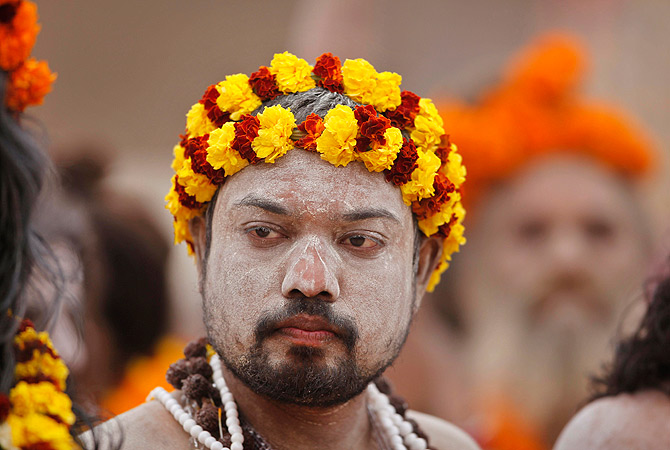 A Naga Sadhu, or Naked Hindu holy man, takes part in a religious procession towards the Sangam, the confluence of rivers Ganges, Yamuna and mythical Saraswati, as part of the Mahakumbh festival in Allahabad, India, Friday, Jan. 4, 2013. ? AP Photo