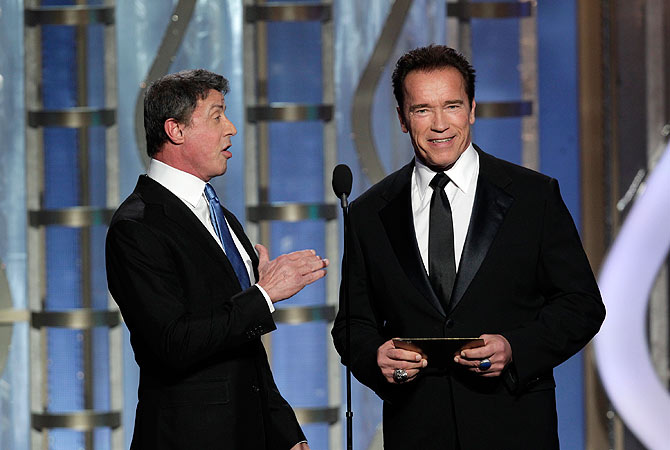 Presenters Sylvester Stallone (L) and Arnold Schwarzenegger at the Golden Globe Awards in Beverly Hills, California January 13, 2013, in this picture provided by NBC. — Reuters Photo