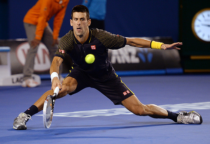 Serbia's Novak Djokovic makes a forehand return to Britain's Andy Murray during the men's final at the Australian Open tennis championship in Melbourne, Australia, Sunday, Jan. 27, 2013– Photo by AP