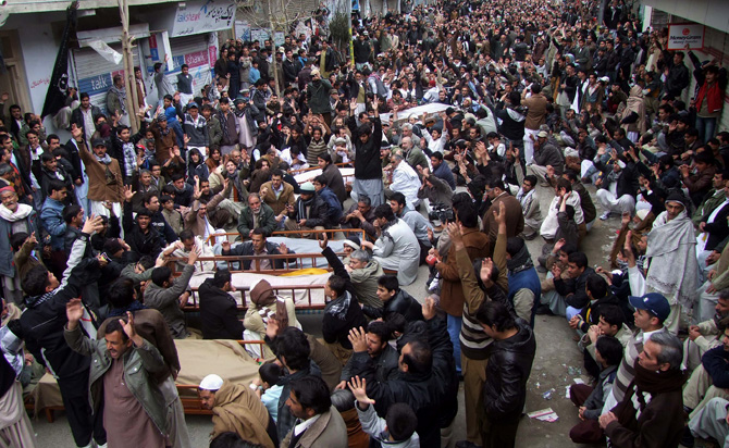 People chant slogans next to the bodies of their relatives awaiting burial, who were killed in Thursday's deadly bombings, at a protest rally on Friday, January 11, 2013 in Quetta. – Photo by AP