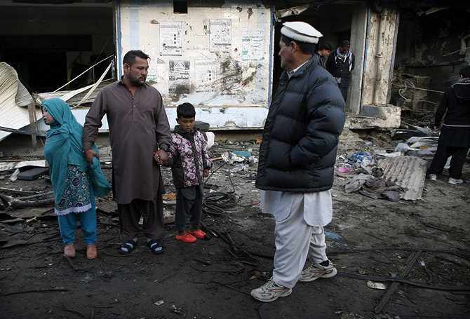 People inspect the site of yesterday's bomb blast in Quetta January 11, 2013. – Photo by Reuters