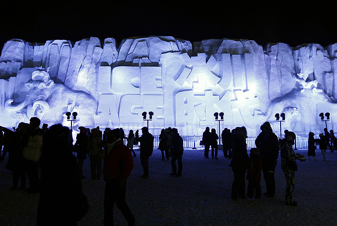 Visitors looking at a huge snow sculpture in Ice and Snow World at the opening ceremony of the 2013 Harbin International Ice and Snow Festival in Harbin. ? AFP Photo
