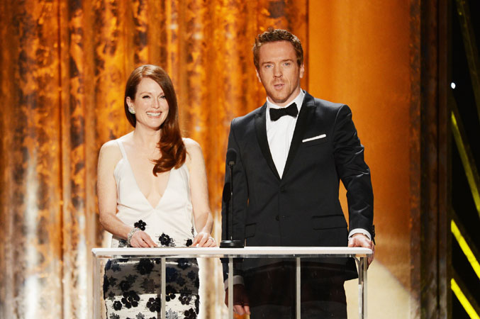 Actors Julianne Moore and Damian Lewis speak onstage. ?Photo by AFP