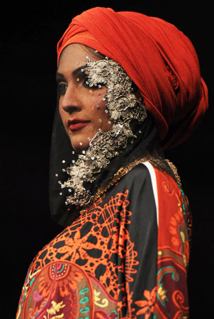 A Pakistani model presents a creation by Malaysian designer Sharifah Kirana. ?Photo by AFP