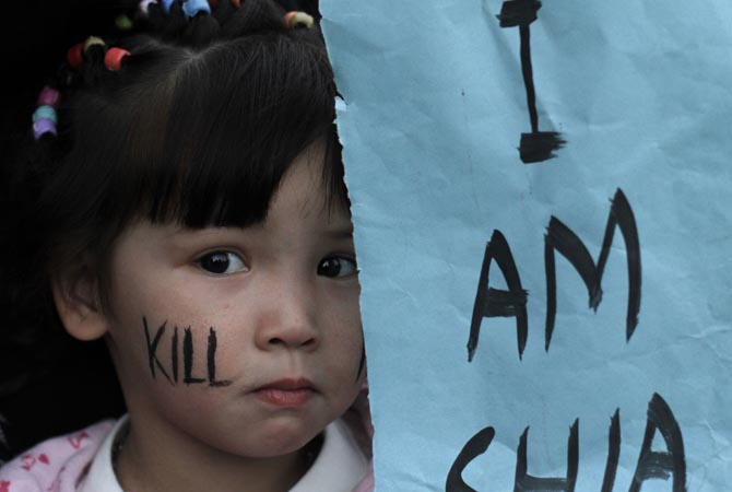 A girl, takes part in a protest to condemn Thursday's deadly bombings in Quetta, in Karachi, Pakistan.—Photo by AP