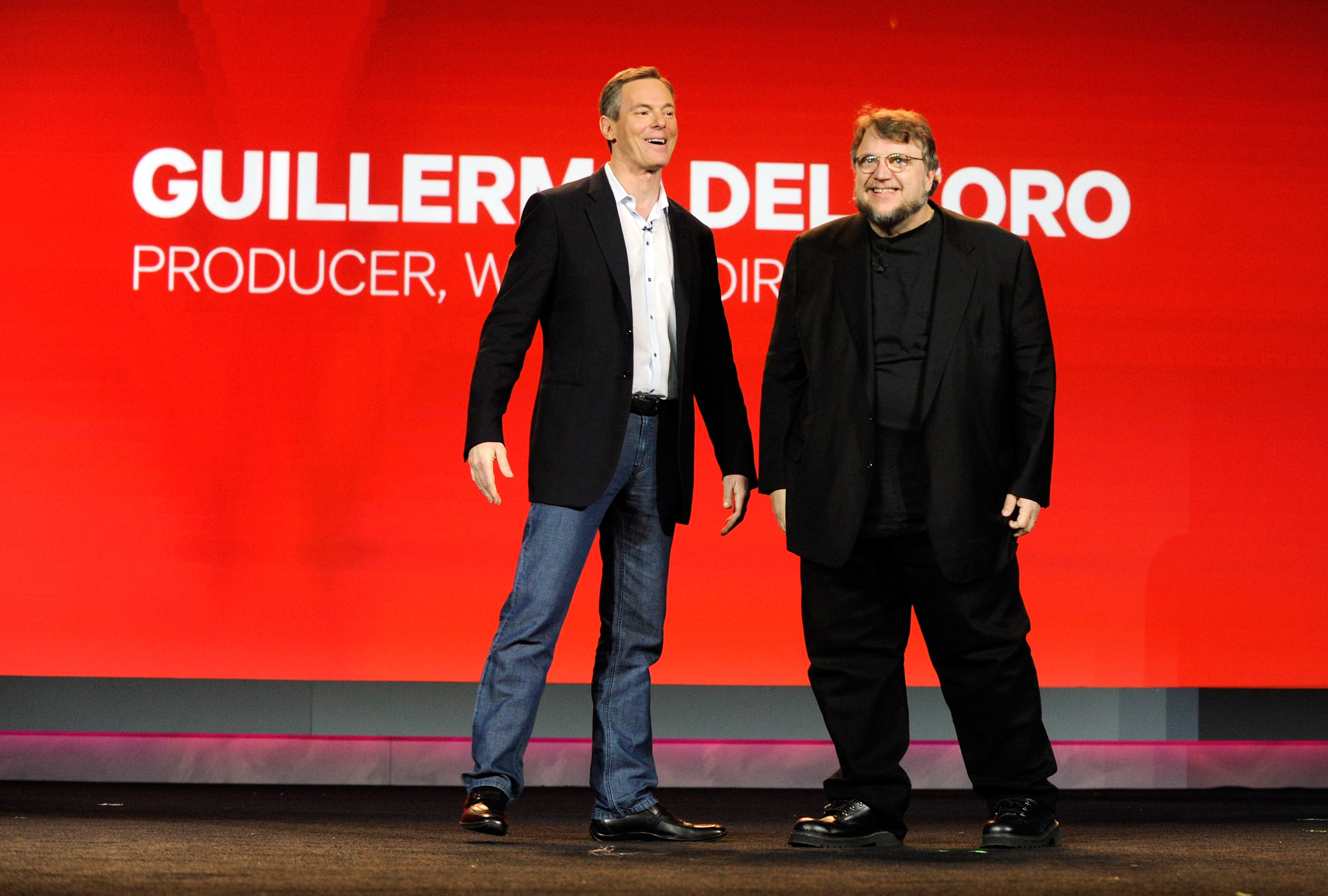 LAS VEGAS, NV - JANUARY 07: Qualcomm Inc., Chairman and CEO Dr. Paul E. Jacobs (L) and director Guillermo del Toro appear on stage during a keynote address at the 2013 International CES at The Venetian on January 7, 2013 in Las Vegas, Nevada. CES, the world's largest annual consumer technology trade show, runs from January 8-11 and is expected to feature 3,100 exhibitors showing off their latest products and services to about 150,000 attendees. - AFP Photo
