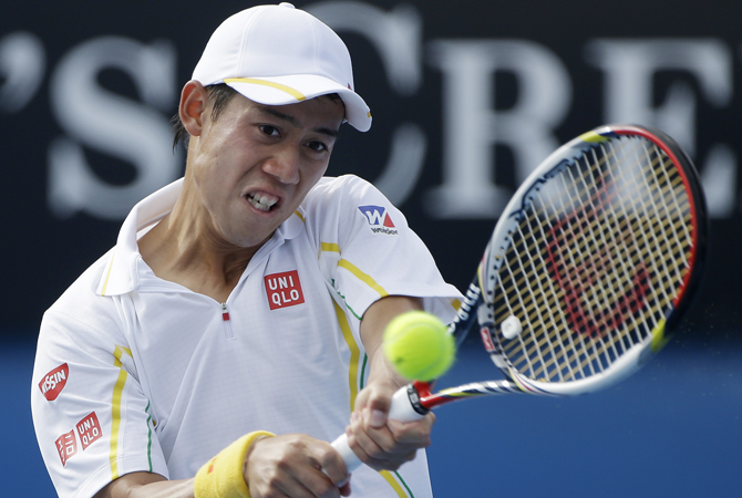 Japan's Kei Nishikori hits a return to Russia's Evgeny Donskoy during their third round match at the Australian Open tennis championship in Melbourne, Australia. ? Photo by AP