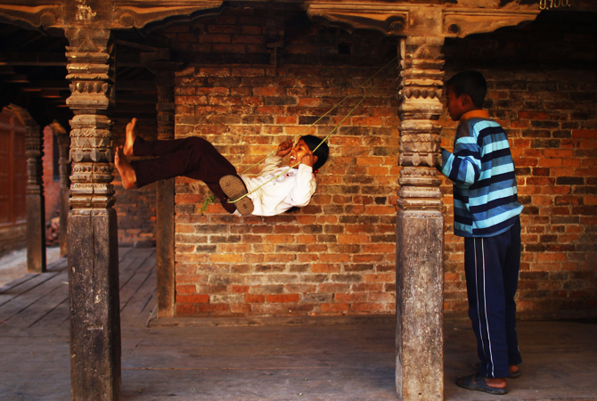 Nepalese children play in an old house at Bhaktapur, Nepal, Friday.