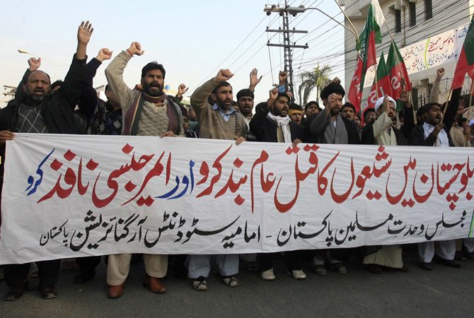 "Supporters of the Imamia Students Organisation (ISO) and the Majlis-e-Wahdat-e-Muslimeen (MWM) religious group attend a protest against the bomb blasts in Quetta a day earlier, in Lahore January 11, 2013. The banner reads, ""Bloody Quetta. Stop the mass murder of Shi'ites in Baluchistan and impose a state of emergency.""  – Photo by Reuters"