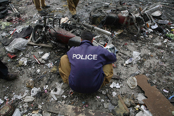 A Bomb disposal squad member checks the site of a blast a  in Quetta January 10, 2013. – Photo by Reuters