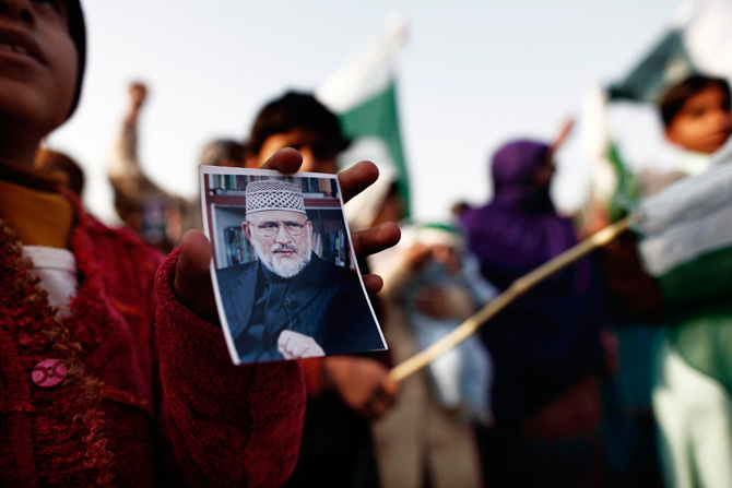 A girl holds a photograph of Muhammad Tahirul Qadri, leader of Mihaj-ul-Quran, during a protest in Islamabad January 14, 2013. ? Photo by Reuters