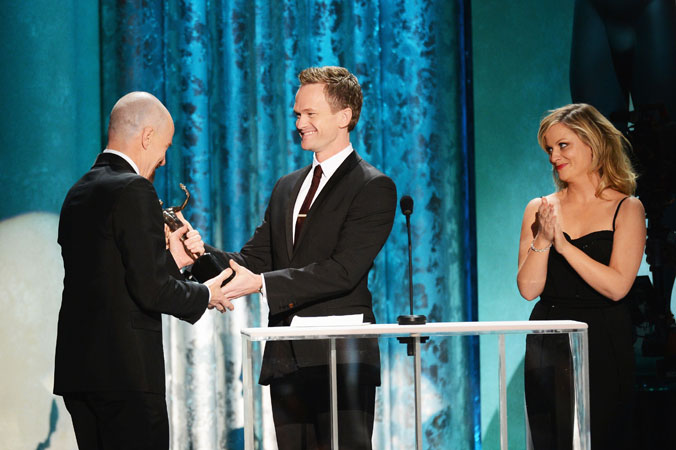 Actors Neil Patrick Harris and Amy Poehler present Bryan Cranston the award for ?Outstanding Performance by a Male Actor in a Drama Series? for 'Breaking Bad' onstage. ?Photo by AFP