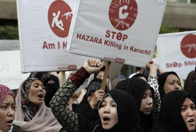 Women chant slogans during a protest to condemn Thursday's deadly bombings in Quetta, in Karachi, Pakistan. Thousands of Shia's in Pakistan protested in southwestern Pakistan for a second day on Saturday, blocking a main road with dozens of coffins of relatives killed in explosions to demand better security from the government.—Photo by AP