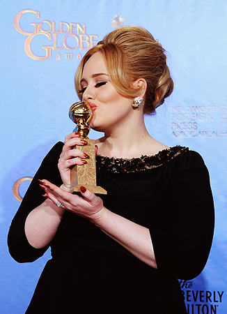 "Singer Adele, winner of Best Original Song for a Motion Picture for ""Skyfall"" from ""Skyfall,"" poses in the press room during the 70th Annual Golden Globe Awards held at The Beverly Hilton Hotel. — AFP Photo"