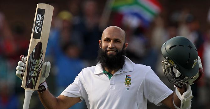 South Africa's batsman Hashim Amla celebrates his century on day one of their second cricket test match against New Zealand at the St Georges Stadium in Port Elizabeth, South Africa. -AP Photo