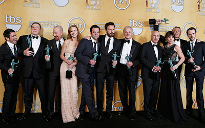 "The cast of ""Argo"" (L-R) Chris Messina, John Goodman, Bryan Cranston, Kerry Bishe, Rory Cochrane, Ben Affleck, Victor Garber, Alan Arkin, Clea DuVall, Tate Donovan and Christopher Denham hold their awards for outstanding performance by a cast in a motion picture for the film ""Argo"" at the 19th annual Screen Actors Guild Awards in Los Angeles, California January 27, 2013.   REUTERS/Adrees Latif (UNITED STATES  - Tags: ENTERTAINMENT)  (SAGAWARDS-BACKSTAGE)"