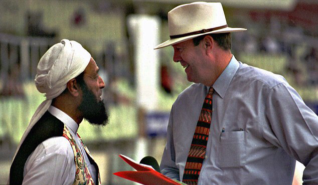 Former England captain and famous commentator, late Tony Grieg (right), talking to former Pakistan player, Saeed Ahmed at the Sharjah Cricket Stadium in 1998. Saeed Ahmed represented Pakistan from 1958 till 1973 and accumulated over 2,500 runs. A stylish one-down batsman, Ahmed was also a 'party animal' with a great fondness for whiskey and women. He was dropped from the Pakistan side when in 1973, just before the third Test against Australia in Sydney; Ahmed faked an injury and sat outside after seeing a hard, fast, and green-top wicket. He continued to play cricket in England but then vanished from the radar. He reappeared in 1998, as a recruiting man for the Tableeghi Jamat. He had become a 'born again Muslim' sometime in the 1980s, joined the TJ, and in the late 1990s set about to recruit famous cricketers for the organisation. His first catches were Saeed Anwar, Saqlain Mushtaq and Mushtaq Ahmed.