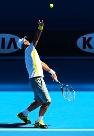 Spain's Fernando Verdasco serves against Belgium's David Goffin during their men's singles first round match.