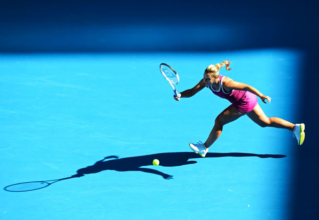 Slovakia's Dominika Cibulkova hits a return against Australia's Ashleigh Barty during their women's singles first round match.